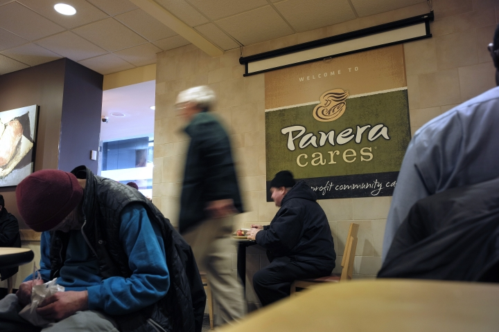 In this Wednesday, Feb. 13, 2019 photo, customers sit in a Panera Cares restaurant in Boston. The company is closing the last of its experimental cafes that let customers pay what they wished. It says this Panera Cares location will close Friday, Feb. 14, 2019, after six years. (AP Photo/Steven Senne)