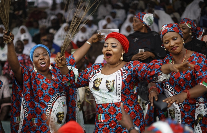 Supporters of incumbent President Muhammadu Buhari sing and dance in advance of his arrival at a campaign rally in Abuja, Nigeria Wednesday, Feb. 13, 2019. Nigeria is due to hold general elections on Saturday, Feb. 16, 2019. (AP Photo/Ben Curtis)