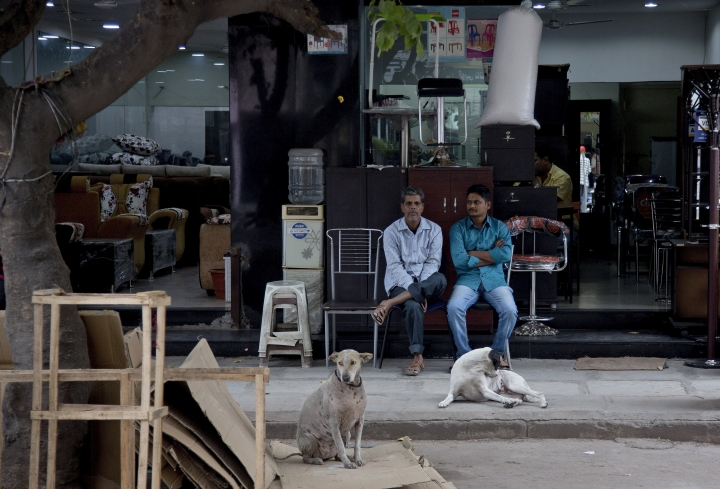 In this Dec. 17, 2018, photo, salesmen wait for customers at a shop at the Nampally furniture market in Hyderabad, India. This furniture market, where customers haggle over prices and work with carpenters to design made-to-order housewares, is the kind of competition Swedish giant Ikea faces in tackling the $40 billion Indian market for home furnishings, which is growing quickly along with the country's consumer class. Six months after Ikea opened its first store in Hyderabad on Aug. 9, the 400,000-square-foot cornucopia of furniture, linens, kitchenware, and other goodies is drawing between 10,000 and 30,000 visitors per day. (AP Photo/Mahesh Kumar A.)