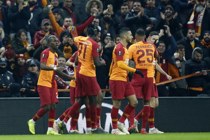 Galatasaray players celebrated a goal against Benfica during the Europa League round of 32 soccer match between Galatasaray and Benfica, in Istanbul, Thursday, Feb. 14, 2019. (AP Photo/Lefteris Pitarakis)