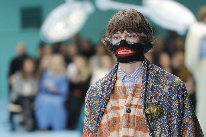 FILE - In this Feb. 21, 2018, file photo, a model wears a creation as part of the Gucci women's Fall/Winter 2018-2019 collection, presented during the Milan Fashion Week, in Milan, Italy. Italian fashion designer Gucci is announcing a major push to step up its diversity hiring following an uproar over an $890 sweater that resembled blackface, Friday, Feb. 15, 2019. The company also says it will hire a global director for diversity and inclusion, a newly created role. Gucci also is promising to launch a scholarship program to cultivate diverse design talent. (AP Photo/Antonio Calanni, File)