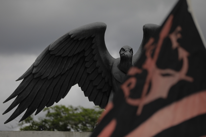 A statue of a vulture, the mascot symbol of Brazil's Flamengo soccer team, is seen atop the entrance of the soccer club training complex in Rio de Janeiro, Brazil, Friday, Feb. 8, 2019. A fire tore through the sleeping quarters of the Flamengo soccer club development league, one of Brazil's most popular professional soccer clubs, killing several people who were most likely players and injuring others, authorities said. (AP Photo/Leo Correa)