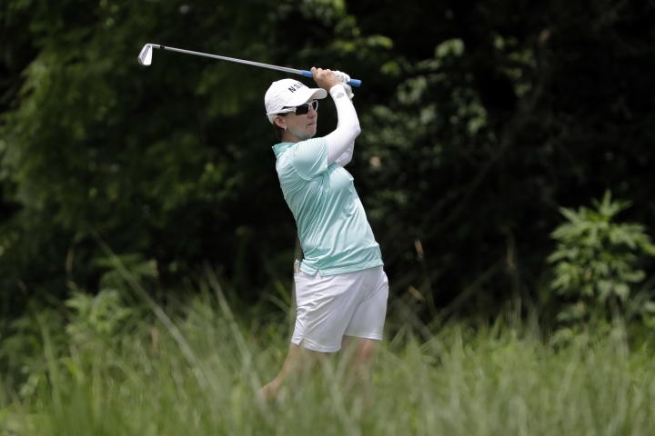 FILE - In this June 27, 2018, file photo, Karrie Webb, of Australia, watches her tee shot on the 17th hole during a practice round for the KPMG Women's PGA Championship golf tournament at Kemper Lakes Golf Course in Lake Zurich, Ill. Webb's bid for a sixth Women's Australian Open title began with a 5-under 67 at The Grange, Thursday, Feb. 14, 2019, leaving her two strokes behind first-round leaders Jodi Ewart Shadoff and Wei-Ling Hsu. (AP Photo/Nam Y. Huh, File)