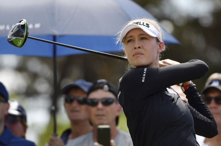 Nelly Korda of the United States tees off on her way to winning the Women's Australian Open golf tournament in Adelaide, Australia Sunday, Feb. 17, 2019. (AAP Image/David Mariuz)