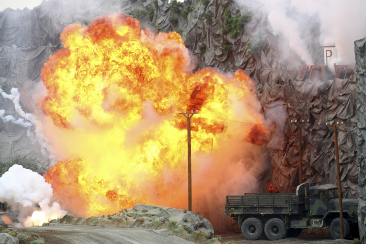 "An explosion strikes during a military demonstration targeting a theatrical ""ballistic missile launchpad"" at the International Defense Exhibition and Conference in Abu Dhabi, United Arab Emirates, Sunday, Feb. 17, 2019. The biennial arms show in Abu Dhabi comes as the United Arab Emirates faces increasing criticism for its role in the yearlong war in Yemen. (AP Photo/Jon Gambrell)"