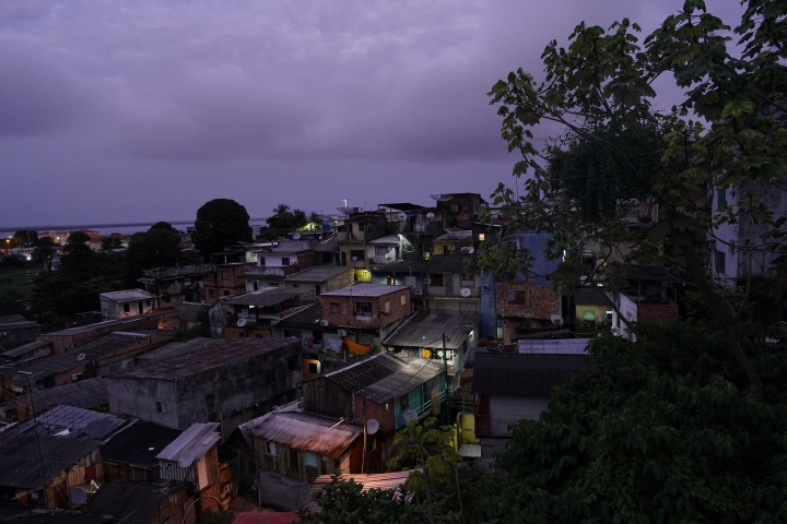 "The sun rises over a neighborhood in Manaus, Brazil, Saturday, Feb. 16, 2019. The largest city in Brazil's Amazon region hosted the annual gigantic Amazon Peladao soccer tournament. ""Pelada,"" in Portuguese ""naked"" or ""bare,"" is what Brazilians call amateur soccer, often played on improvised pitches on streets, fields, beaches and river banks. (AP Photo/Victor R. Caivano)"