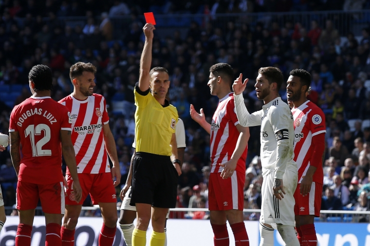 Real Madrid's Sergio Ramos, second right, receives a red card during a La Liga soccer match between Real Madrid and Girona at the Bernabeu stadium in Madrid, Spain, Sunday, Feb. 17, 2019. (AP Photo/Andrea Comas)