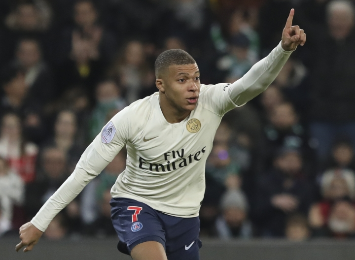 PSG forward Kylian Mbappe celebrates after scoring the opening goal during the French League One soccer match between Saint-Etienne and Paris Saint-Germain, at the Geoffroy Guichard stadium, in Saint-Etienne, central France, Sunday, Feb. 17, 2019. (AP Photo/Laurent Cipriani)