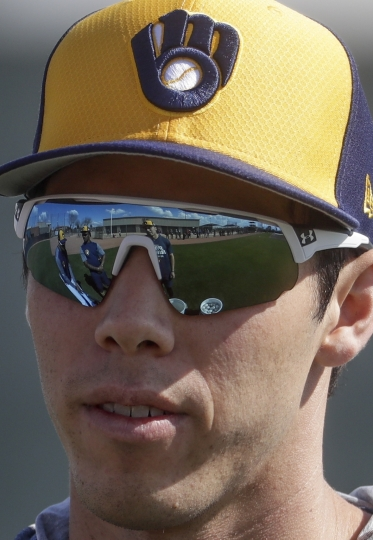 Milwaukee Brewers' Christian Yelich talks to teammates during a spring training baseball workout Sunday, Feb. 17, 2019, in Phoenix. (AP Photo/Morry Gash)