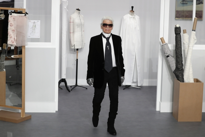 FILE - In this Tuesday, July 5, 2016 file photo, Karl Lagerfeld arrives at the end of Chanel's Haute Couture Fall-Winter 2016-2017 fashion collection presented in Paris. Chanel's iconic couturier, Karl Lagerfeld, whose accomplished designs as well as trademark white ponytail, high starched collars and dark enigmatic glasses dominated high fashion for the last 50 years, has died. He was around 85 years old. (AP Photo/Francois Mori, File )