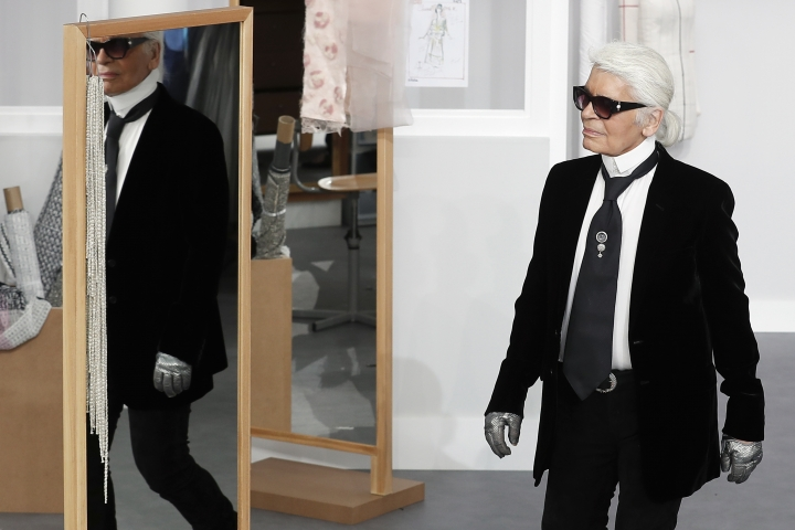 FILE - In this Tuesday, July 5, 2016 file photo, Karl Lagerfeld arrives at the end of Chanel's Haute Couture Fall-Winter 2016-2017 fashion collection presented in Paris. Chanel's iconic couturier, Karl Lagerfeld, whose accomplished designs as well as trademark white ponytail, high starched collars and dark enigmatic glasses dominated high fashion for the last 50 years, has died. He was around 85 years old. (AP Photo/Francois Mori, File)