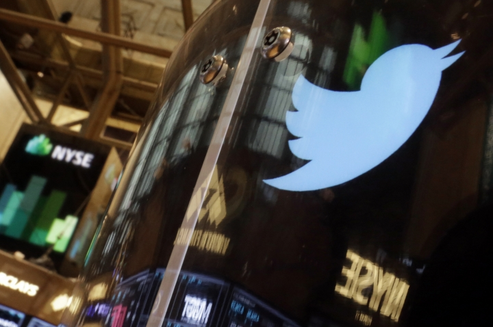 FILE - In this Nov. 6, 2013 file photo, the Twitter bird logo is on an updated phone post on the floor of the New York Stock Exchange. Social media company Twitter says Tuesday Feb. 19, 2019, it is tightening up rules for European Union political ads ahead of bloc-wide elections set for the spring of 2019, following similar moves by fellow tech giants Facebook and Google. (AP Photo/Richard Drew, FILE)