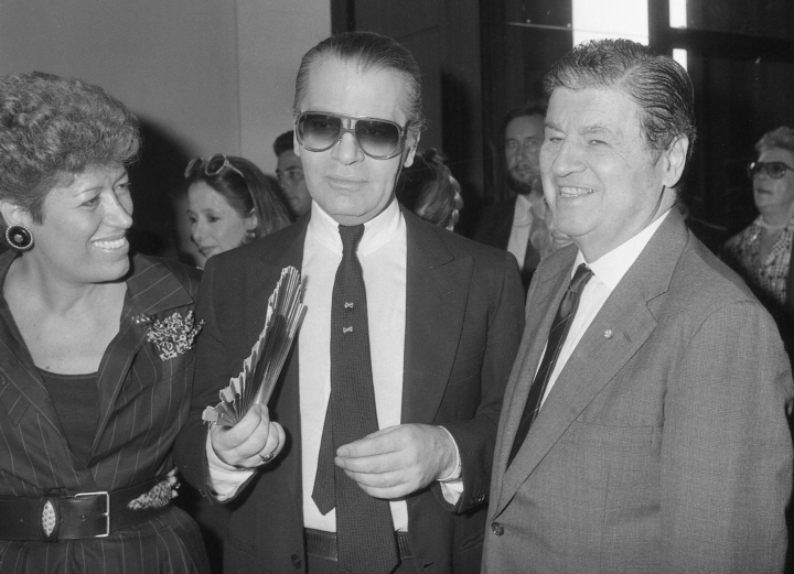 FILE - In this Oct. 5, 1985 file photo, from left, Carla Fendi, Karl Lagerfeld and U.S. Ambassador to Rome, Maxwell Rabb, attend the opening of an exhibition at Rome's National Gallery of Modern Art to celebrate the 20-year-collaboration between Lagerfeld and Fendi. Chanel's iconic couturier, Karl Lagerfeld, whose accomplished designs as well as trademark white ponytail, high starched collars and dark enigmatic glasses dominated high fashion for the last 50 years, has died. He was around 85 years old. (AP Photo/Massimo Sambucetti, File )