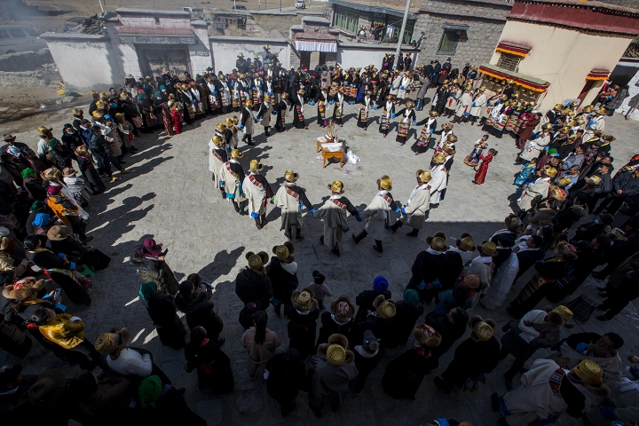 In this Feb. 17, 2019, photo released by Xinhua News Agency, people perform dance to celebrate the Tibetan New Year in Doilungdeqen of Lhasa, southwest China's Tibet Autonomous Region. China is barring foreign travelers from Tibet over a period of several weeks that includes a pair of sensitive political anniversaries. Travel agencies contacted Wednesday, Feb. 20 said foreign tourists would not be allowed into the Himalayan region until April 1. (Nam Jer/Xinhua via AP)