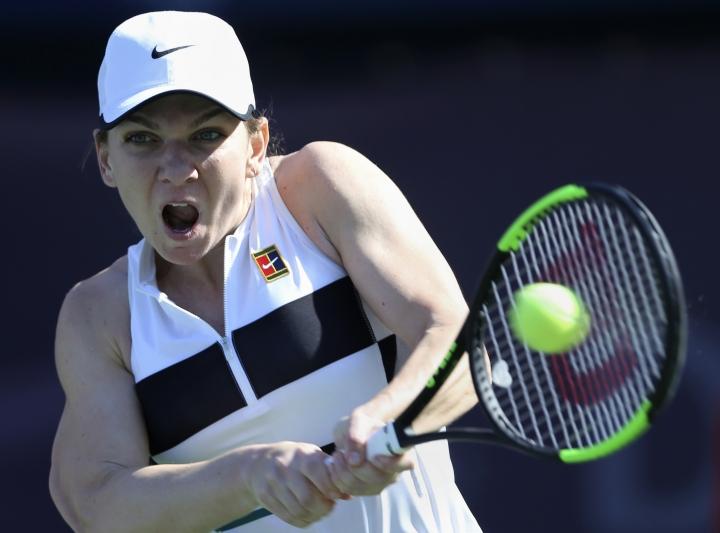 Ukraine's Leisa Tsurenko returns the ball to Romania's Simona Halep during a match of the Dubai Duty Free Tennis Championship in Dubai, United Arab Emirates, Wednesday, Feb. 20, 2019. (AP Photo/Kamran Jebreili)
