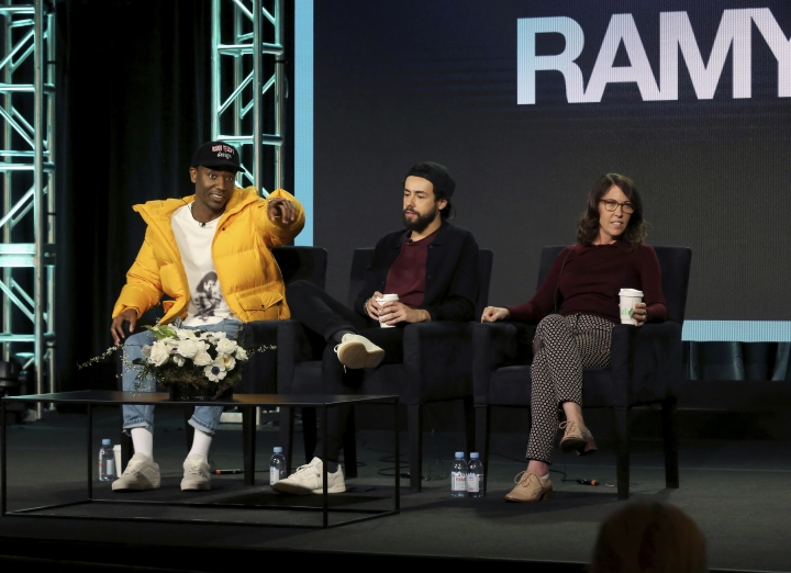 "FILE - In this Feb. 11, 2019 file photo, Jerrod Carmichael, from left, Ramy Youssef and Bridget Bedard participate in the ""Ramy"" panel during the Hulu presentation at the Television Critics Association Winter Press Tour in Pasadena, Calif. Carmichael lamented what he called the ""terrible"" state of TV comedy, asked his audience if they'd seen some of it. (Photo by Willy Sanjuan/Invision/AP, File)"