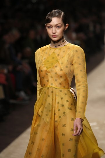 Model Gigi Hadid wears a creation as part of the Fendi women's Fall-Winter 2019-2020 collection, that was presented in Milan, Italy, Thursday, Feb.21, 2019. (AP Photo/Antonio Calanni)
