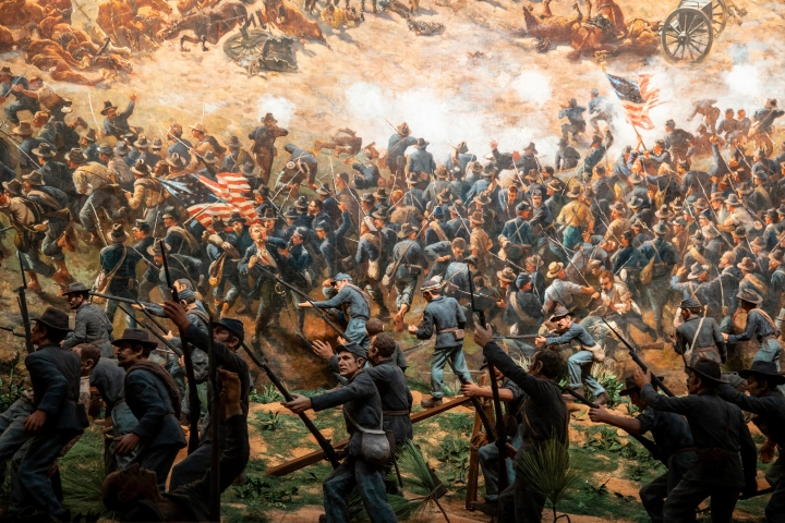 In this Friday, Feb 15, 2019 photo, The Atlanta Cyclorama, an enormous painting more than 100 years old, is seen at the Atlanta History Center on Friday, Feb 15, 2019, in Atlanta. The Atlanta Cyclorama depicts charging horses, wounded soldiers, cannon blasts and smoke as Union troops defeated Confederate forces and then torched much of the city. (Atlanta History Center via AP)