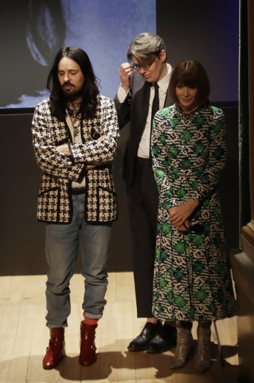 American Vogue editor-in-chief Anna Wintour, right, Gucci creative director Alessandro Michele, left, and curator Andrew Bolton stand during the presentation of this year's Costume Institute exhibition titled ''Camp: Notes on Fashion,'' at the Teatro Gerolamo, in Milan, Italy, Friday, Feb. 22, 2019. The exhibition will be shown at the Metropolitan Museum of Art of New York, from May 9-Sept. 8, 2019. (AP Photo/Luca Bruno)