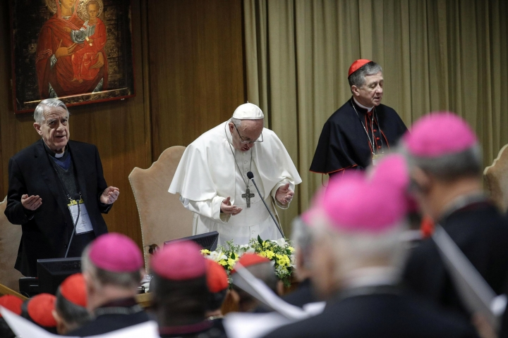 Pope Francis prays during the opening of the second day of a Vatican's conference on dealing with sex abuse by priests, at the Vatican, Friday, Feb. 22, 2019. Pope Francis has issued 21 proposals to stem the clergy sex abuse around the world, calling for specific protocols to handle accusations against bishops and for lay experts to be involved in abuse investigations. (Giuseppe Lami/Pool Photo via AP)