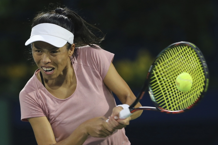 Su-Wei Hsieh of Taiwan returns the ball to Czech Republic's Petra Kvitova during their women's singles semifinals match of the Dubai Duty Free Tennis Championship in Dubai, United Arab Emirates, Friday, Feb. 22, 2019. (AP Photo/Kamran Jebreili)