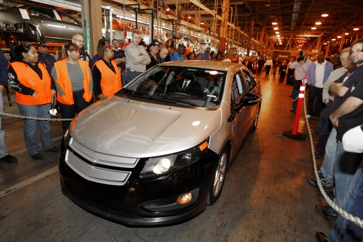 FILE - In this Dec. 7, 2009 file photo, a pre-production Chevrolet Volt is driven at the General Motors Hamtramck Assembly plant during a news conference in Hamtramck, Mich. General Motors has stopped making the Chevrolet Volt, a ground-breaking electric car with a gasoline backup motor. The last Volt rolled off the assembly line at a Detroit factory with little ceremony on Tuesday, Feb. 26, 2019. (AP Photo/Carlos Osorio, File)