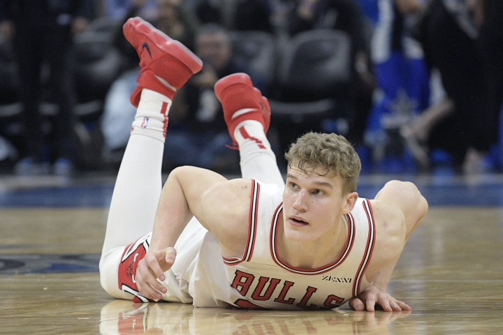 Chicago Bulls forward Lauri Markkanen (24) watches from the floor after being fouled by Orlando Magic forward Aaron Gordon on a three-point shot at the end of the second half of an NBA basketball game Friday, Feb. 22, 2019, in Orlando, Fla. (AP Photo/Phelan M. Ebenhack)