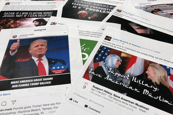 "Some of the Facebook and Instagram ads linked to a Russian effort to disrupt the American political process and stir up tensions around divisive social issues, released by members of the U.S. House Intelligence committee, are photographed in Washington, on Wednesday, Nov. 1, 2017. A report compiled by private researchers and released by the Senate intelligence committee Monday says that ""active and ongoing"" Russian interference operations still exist on social media platforms, and that the Russian operation discovered after the 2016 presidential election was much broader than once thought. (AP Photo/Jon Elswick)"