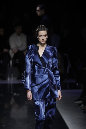 A model wears a creation as part of the Giorgio Armani women's Fall-Winter 2019-2020 collection, that was presented in Milan, Italy, Saturday, Feb. 23, 2019. (AP Photo/Luca Bruno)