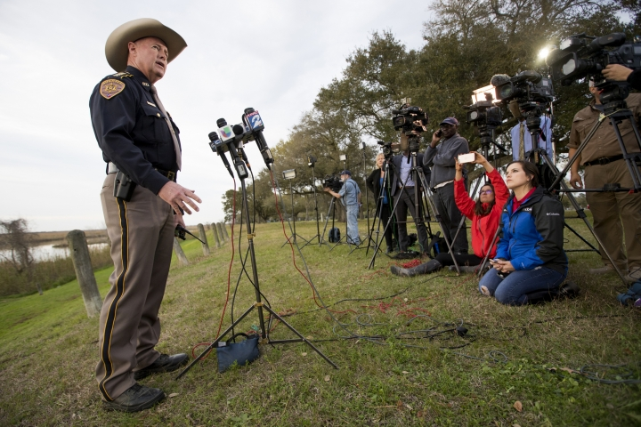 Chambers County Sheriff Brian Hawthorne gives an update on a plane crash in Trinity Bay during a news conference in Anahuac, Texas, Saturday, Feb. 23, 2019. A Boeing 767 cargo jetliner heading to Houston with a few people aboard disintegrated after crashing Saturday into the bay east of the city, according to a Texas sheriff. (Brett Coomer/Houston Chronicle via AP)