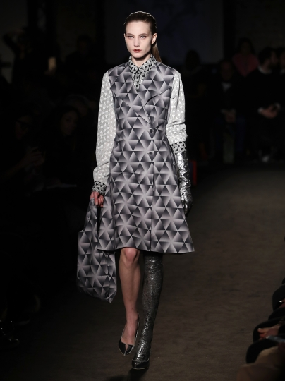 A model wears a creation as part of the Atsushi Nakashima women's Fall-Winter 2019-20 collection, unveiled during the Fashion Week in Milan, Italy, Sunday, Feb. 24, 2019. (AP Photo/Antonio Calanni)
