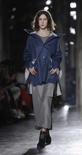 A model wears a creation part of the Ujoh women's Fall-Winter 2019-2020 collection, that was presented in Milan, Italy, Sunday, Feb.24, 2019. (AP Photo/Luca Bruno)