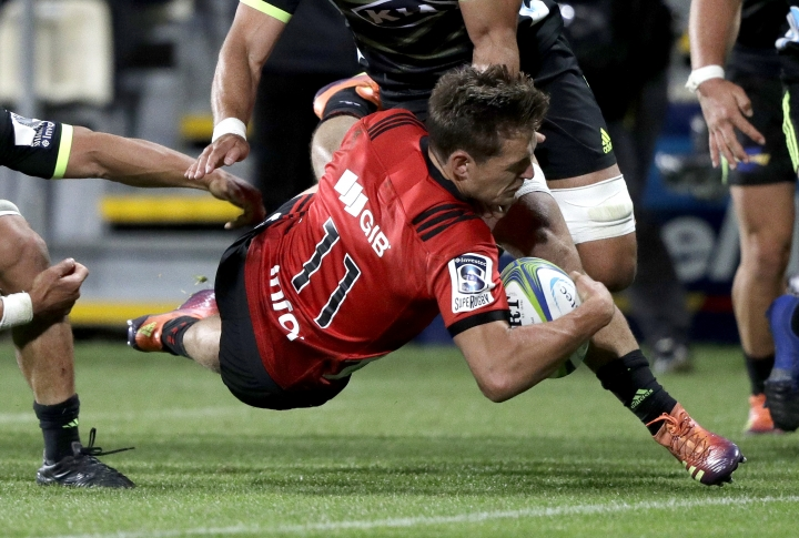 Crusaders George Bridge is airborne as he scores a try during the Super Rugby game between the Crusaders and Hurricanes in Christchurch, New Zealand, Saturday, Feb. 23, 2019. (AP Photo/Mark Baker