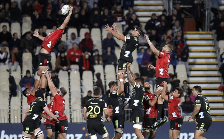 Crusaders Whetukamokamo Douglas steals a line out ball from the Hurricanes during the Super Rugby game between the Crusaders and Hurricanes in Christchurch, New Zealand, Saturday, Feb. 23, 2019. (AP Photo/Mark Baker)