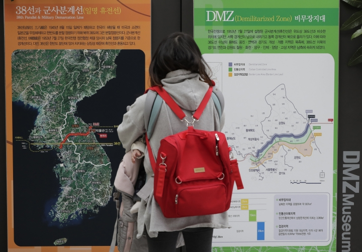 In this Feb. 8, 2019, photo, a visitor looks at a map of the Korean peninsula at the DMZ museum inside a restricted area in Goseong, South Korea. For some observers, the nightmare result of the second summit between U.S. President Donald Trump and North Korean leader Kim Jong Un is an ill-considered deal that allows North Korea to get everything it wants while giving up very little, even as the mercurial leaders trumpet a blockbuster nuclear success. (AP Photo/Lee Jin-man)