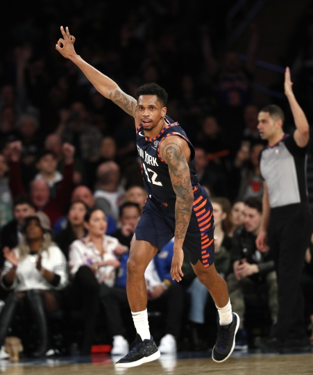 New York Knicks forward Lance Thomas (42) celebrates after sinking a three-point shot during the second half of an NBA basketball game against the San Antonio Spurs in New York, Sunday, Feb. 24, 2019. The Knicks defeated the Spurs 130-118, avoiding tying an NBA record for home losses. (AP Photo/Kathy Willens)