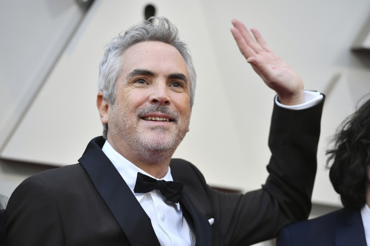 Alfonso Cuaron arrives at the Oscars on Sunday, Feb. 24, 2019, at the Dolby Theatre in Los Angeles. (Photo by Jordan Strauss/Invision/AP)