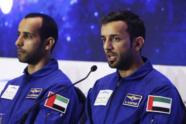 Emirati astronaut Sultan al-Neyadi, right, speaks to journalists with astronaut Hazza al-Mansoori, in Dubai, United Arab Emirates, Monday, Feb. 25, 2019. The UAE said on Monday it will send either astronaut al-Mansoori or al-Neyadi to the International Space Station on Sept. 25 aboard a Russian Soyuz rocket. The UAE has a fledgling space program with big ambitions. (AP Photo/Jon Gambrell)
