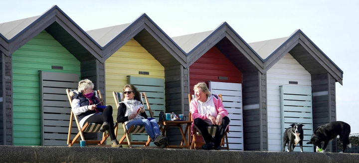 Ladies enjoy lunch in the sun at Blyth in Northumberland, England, Monday, Feb. 25, 2019. Britain's meteorological agency says temperatures have reached 20.3 degrees Celsius (68.54 Fahrenheit) in the west of the country, marking a new record high for February. The Met Office said Monday that the mercury in Trawsgoed, Wales, beat the previous February record of 19.7 degrees Celsius. (Owen Humphreys/PA via AP)