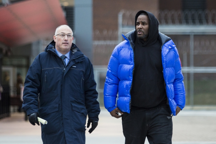 R. Kelly walks out of Cook County Jail with his defense attorney, Steve Greenberg, after posting $100,000 bail, Monday afternoon, Feb. 25, 2019, in Chicago. The R&B star walked out of a Chicago jail Monday after posting $100,000 bail that will allow him to go free while awaiting trial on charges that he sexually abused four people dating back to 1998, including three underage girls. (Ashlee Rezin/Chicago Sun-Times via AP)