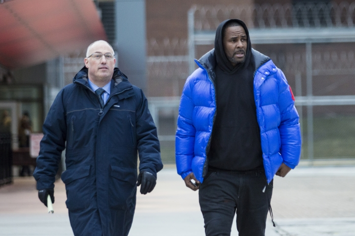 R. Kelly walks out of Cook County Jail with his defense attorney, Steve Greenberg, after posting $100,000 bail, Monday, Feb. 25, 2019 in Chicago. The R&B singer has entered a not guilty plea to all 10 counts of aggravated criminal sexual abuse. (Ashlee Rezin/Chicago Sun-Times via AP)