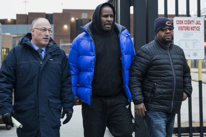 R. Kelly, center, walks out of Cook County Jail with his defense attorney, Steve Greenberg, left, after posting $100,000 bail, Monday afternoon, Feb. 25, 2019, in Chicago. The R&B star walked out of a Chicago jail Monday after posting $100,000 bail that will allow him to go free while awaiting trial on charges that he sexually abused four people dating back to 1998, including three underage girls. (Ashlee Rezin/Chicago Sun-Times via AP)
