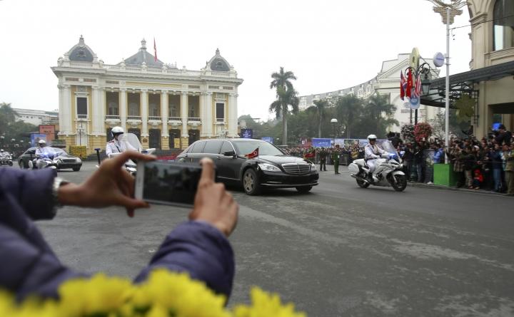 A motorcade of North Korean Kim Jong Un passes Hanoi Opera House, back, in Hanoi, Vietnam Tuesday, Feb. 26, 2019. Kim arrived in Vietnam Tuesday ahead of his second summit with U.S. President Donald Trump. (AP Photo/Hau Dinh)