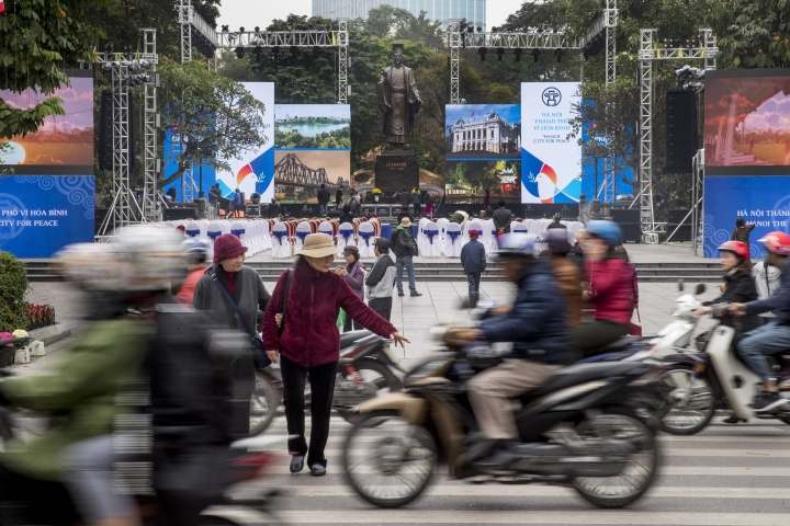 Motorbikes speed past the Emperor Ly Thai To Statue in Hanoi, Vietnam, Tuesday, Feb. 26, 2019, where an event space is being set up for the second summit between U.S President Donald Trump and North Korean leader Kim Jong Un. (AP Photo/Andrew Harnik)
