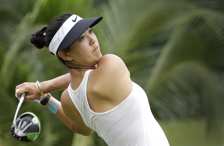 FILE - In this March 4, 2017, file photo, Michelle Wie of the United States tees off on the 2nd hole during the HSBC Women's Champions golf tournament at Sentosa Golf Club's Tanjong course in Singapore. The LPGA Tour completes its four-week swing through Australia and Asia with a healthy Wie defending her title at the 2019 HSBC Women's World Championship at the course. (AP Photo/Wong Maye-E, File)
