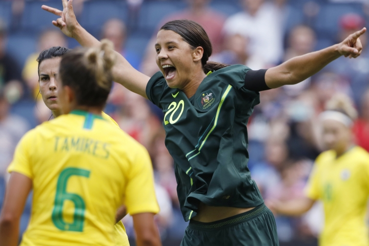 FILE - In this July 26, 2018, file photo, Australia's Sam Kerr, right, celebrates after her team scores against Brazil in the first half of a Tournament of Nations soccer match in Kansas City, Kan. USA. Kerr has been named captain of the women's national soccer, Wednesday, Feb. 27, 2019, as they prepared for Thursday's first match against New Zealand in the four-team Cup of Nations tournament. (AP Photo/Colin E. Braley, File)