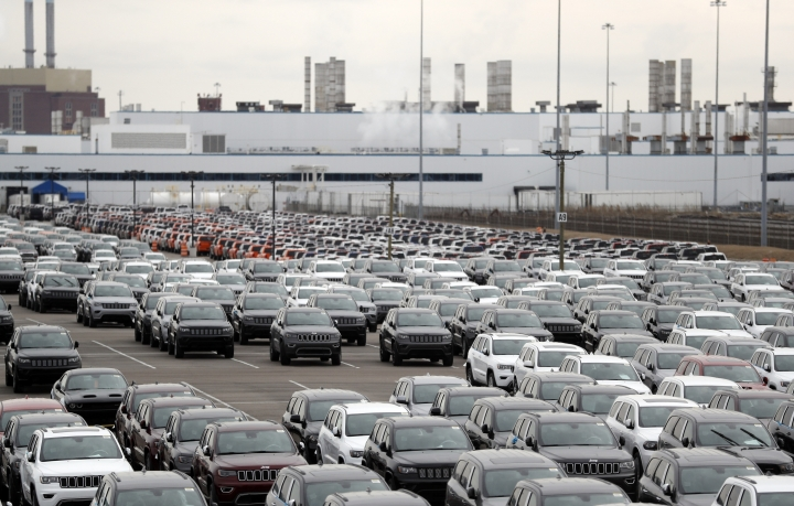 Jeep vehicles are parked outside the Jefferson North Assembly Plant in Detroit, Tuesday, Feb. 26, 2019. Fiat Chrysler announced plans on Tuesday for a new Jeep factory, the city's first new auto plant in a generation, as part of a $4.5 billion manufacturing expansion in southeast Michigan. FCA said it would convert the Mack Avenue Engine factory to an assembly plant for the next-generation Jeep Grand Cherokee and make an investment at Jefferson North Assembly Plant to retool and modernize the factory for continued production of the Dodge Durango. (AP Photo/Carlos Osorio)