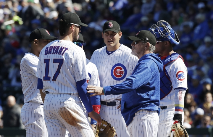 """FILE - In this Feb. 24, 2018, file photo, Chicago Cubs manager Joe Maddon visits the mound during the second inning of a spring training baseball game against the Texas Rangers, in Mesa, Ariz. In the aftermath of Chicago's collapse last season, Cubs manager Joe Maddon went looking for a deeper understanding of the players who dominate the major leagues these days. Maddon's search took him to """"Managing Millennials for Dummies,"""" and the book reinforced what he already felt about the people he worked with every day.(AP Photo/Carlos Osorio, File)"""