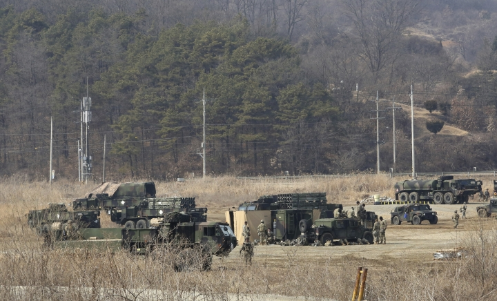 U.S. Army armored vehicles are seen during a military exercise in Yeoncheon, South Korea, near the border with North Korea, South Korea, Wednesday, Feb. 27, 2019. U.S. President Donald Trump has arrived in Vietnam for a second meeting with North Korean leader Kim Jong Un aimed at getting Kim to give up nuclear weapons in exchange for relief from sanctions hobbling his economy and better relations with the U.S. and other nations. (AP Photo/Ahn Young-joon)