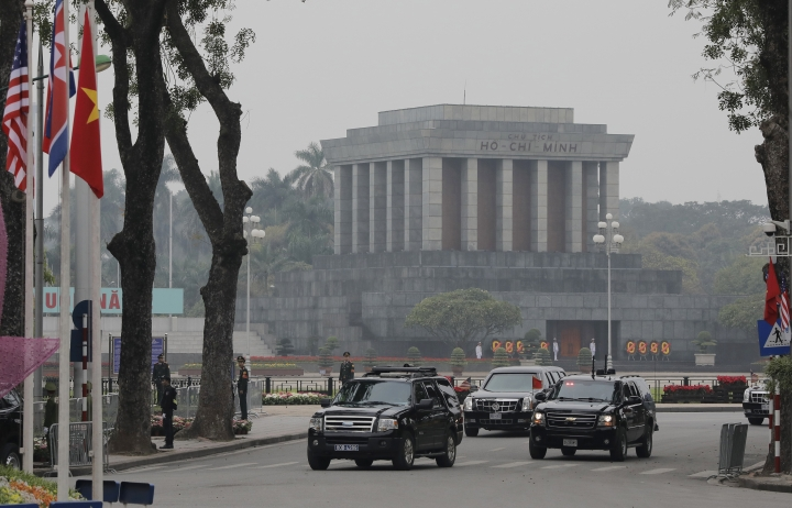 The motorcade carrying U.S President Donald Trump drives past Ho Chi Minh Mausoleum after U.S President Donald Trump visited presidential palace in Hanoi, Vietnam, Wednesday, Feb. 27, 2019. The second summit between U.S President Donald Trump and North Korean leader Kim Jong Un will take place in Hanoi on Feb. 27 and 28. (AP Photo/Vincent Yu)